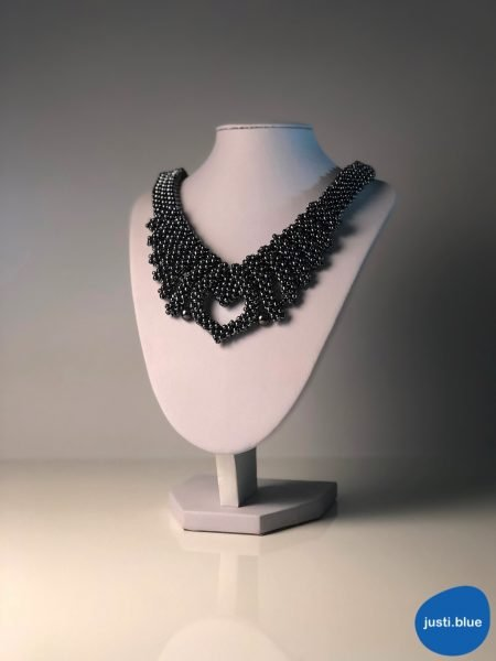 hematite necklace on white jewellery display